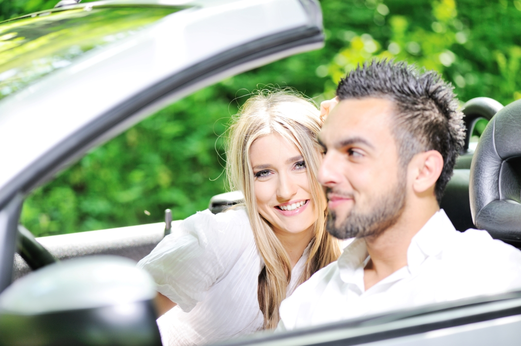 Young lovers in a sports car